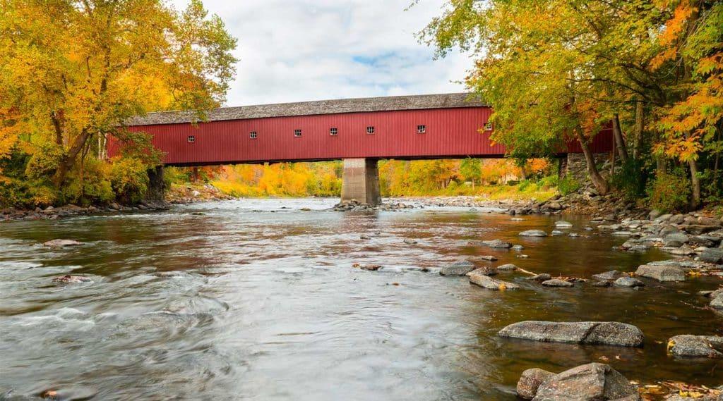 red covered bridge during Autumn in Hamden, Connecticut