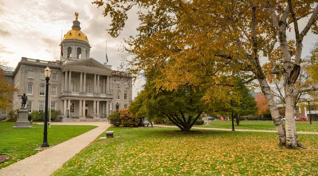 Concord, New Hampshire Town Hall in Fall orange and yellow trees