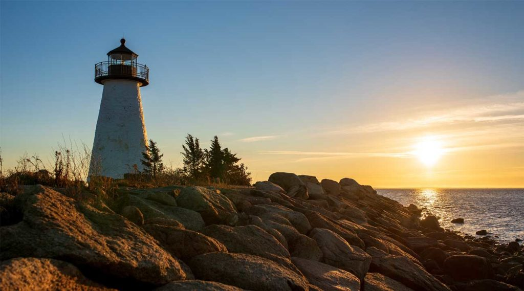 lighthouse at sunset in Plymouth, MA