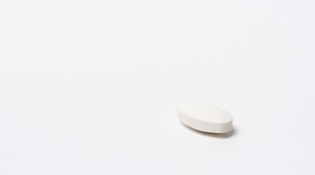 white oval shaped pill resembling an Ambien sleeping pill