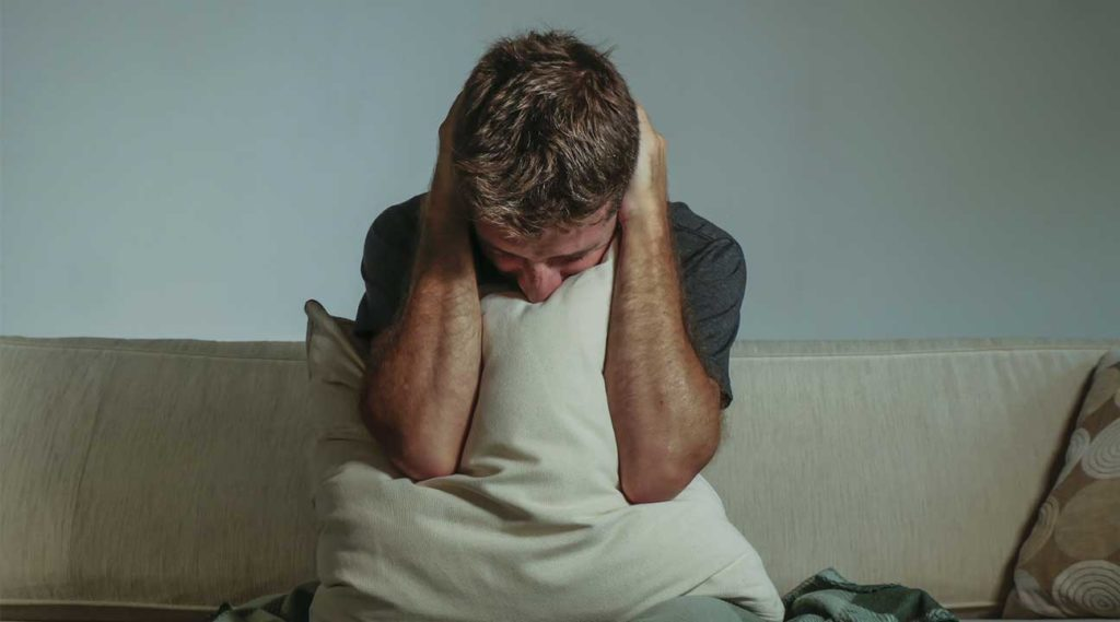 young man experiencing the dangers of at home alcohol detox alcohol withdrawal symptoms