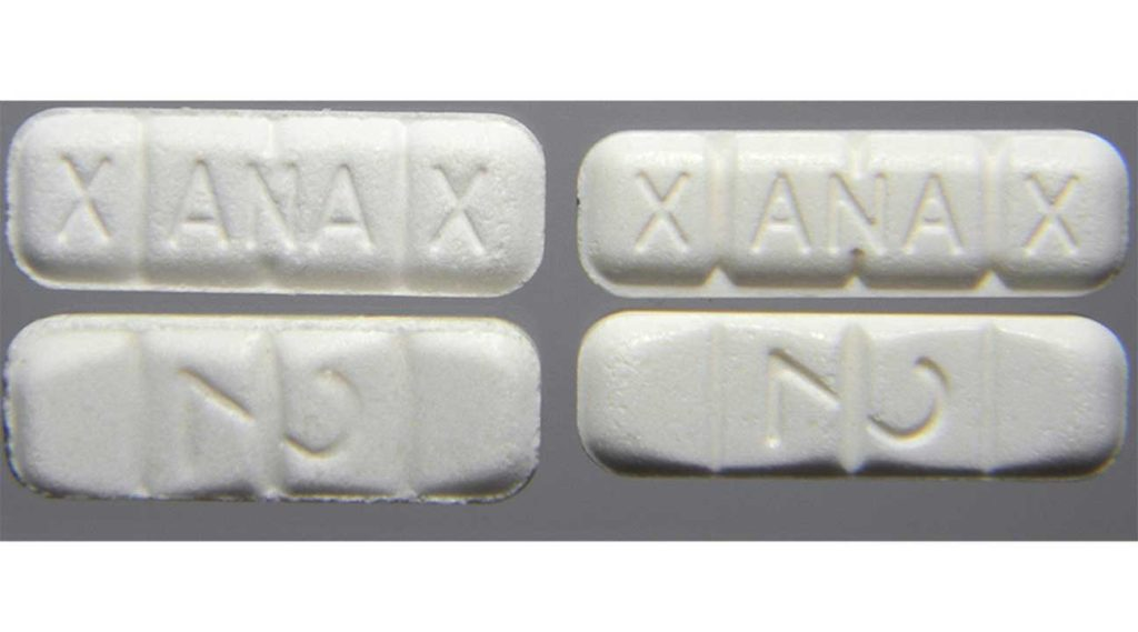 comparing fake Xanax pills to real or authentic xanax pills