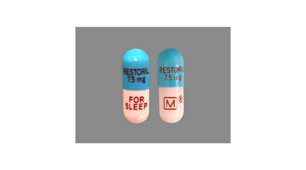 image of two restoril temazepam pills blue and white side effects of restoril