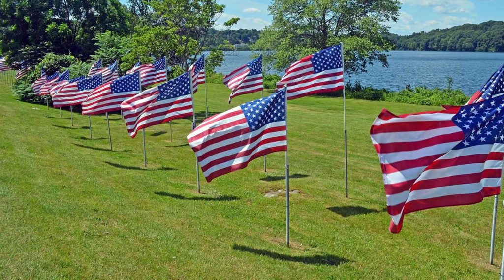 American flags on a hillside near a lake in Carmel, New York
