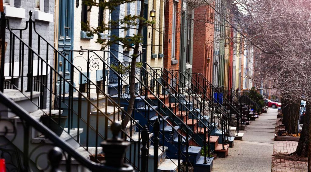 stoops steps along a busy street in Lancaster, New York